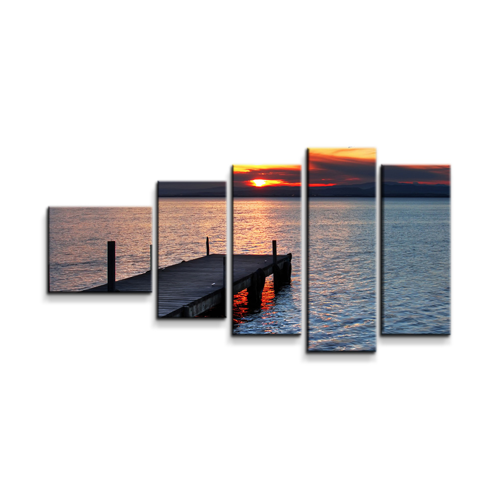 Západ slunce nad molem