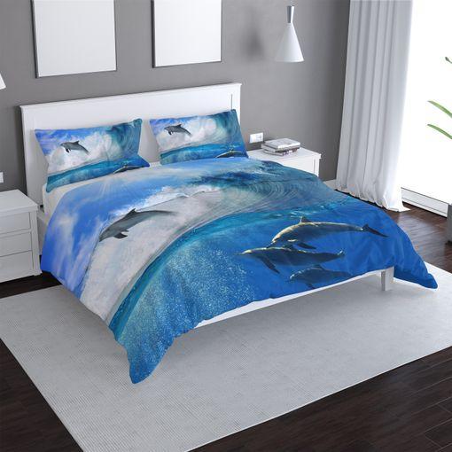 Delfíni ve vlnách